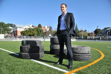 Pacific Rubber co-founder Andrew Christie on St Peter's College's synthetic sports field. Photo / Supplied