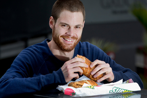 Graphic design student Joe Tiddy enjoys a healthy sandwich and fruit when he eats out. Photo / Sarah Ivey