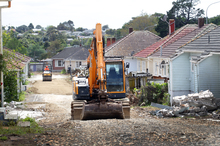 Work has begun to demolish 96 houses to make way for the Waterview Rd motorway extension in Auckland. Photo / Doug Sherring