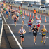 Runners cross the Auckland Harbour Bridge. Photo / Richard Robinson