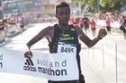 Sleepyhead Kenyan Edwin Kaitany crosses the finish to win the Auckland half marathon yesterday. Photo / Richard Robinson.