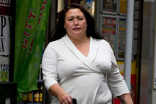 Caroline Wood, the wife of alleged conman Loizos Michaels, arrives at the Auckland District Court to give evidence for the Crown.  Photo / Brett Phibbs