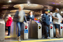 Passengers use the new intergrated ticketing gates at Britomart, Auckland. Photo / Steven McNicholl
