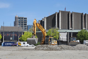 Excavation machinery at work on the empty Convention Centre site, with the earthquake damaged Christchurch Town Hall in the background. Photo / Christchurch Star
