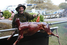 Game chef Tony Lolaiy marinates a young deer. Without the marinade the outside would dry and toughen. Photo / Geoff Thomas