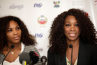 Serena (left) has visited other African nations before, while Venus landed on the continent for the first time. Photo / AP