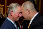 Britain's Prince Charles is greeted by Bruce Simpson from the Ngati Ranana London Maori Club, at St. James's Palace ahead of his trip. Photo / AP