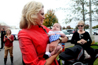 Ann Romney, wife of Republican presidential candidate, Mitt, holds eight-month-old Taylor Roundtree during a campaign stop at the Back Bay Gourmet in Virginia Beach. Photo / AP