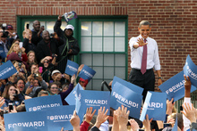 President Barack Obama waves to supporters as he arrives for a campaign event at Elm Street Middle School in New Hampshire. Photo / AP