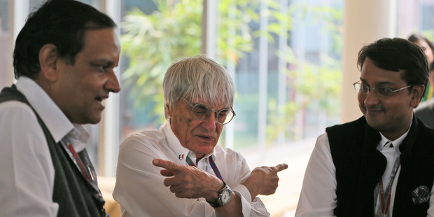 Bernie Ecclestone, centre, gets a birthday gift before the Indian Grand Prix. Photo / AP