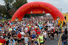 Runners start the Marine Corps Marathon, in Washington, just days before Hurricane Sandy made landfall. Photo / AP