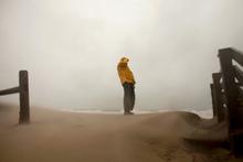 Rains ahead of Hurricane Sandy blow across the beaches of Sandbridge in Virginia Beach. Photo / AP