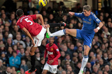 Chelsea's Fernando Torres, right, competes with Manchester United's Rio Ferdinand. Photo / AP