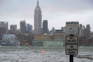 The Hudson River swells and rises over the banks of the Hoboken, N.J. waterfront. Photo / AP