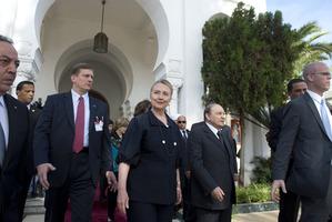 US Secretary of State Hillary Rodham Clinton, walks alongside Algerian President Abdelaziz Bouteflik. Photo / AP