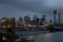 The lights on the Brooklyn Bridge stand in contrast to the lower Manha