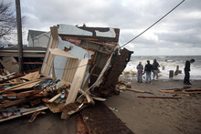 The devastation wrought by Hurricane Sandy has distracted voters from the election. Photo / AP