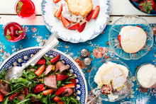 (Clockwise from top) Strawberry and coconut icecream sandwiches; strawberry shortcakes; strawberry salad with venison, rocket, pistachio and balsamic. Photo / Babiche Martens