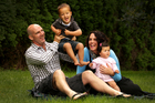 Andrew Fitzgerald at home yesterday with son Johnny, 2, and his wife, Emma, holding 8-month-old Livvy. Photo / Alan Gibson