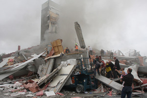 Rescuers search for survivors on top of rubble at the CTV site. Photo / Geoff Sloan