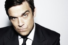 Robbie Williams says he's a loved up father.Photo / File
