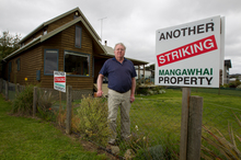 More than 500 Mangawhai residents refuse to pay an estimated $1 million or more to the debt-ridden Kaipara District Council. Photo / Steven McNicholl