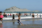 It's expected that New Zealanders will be able to spend more days over summer having fun at the beach and less time sheltering from the rain. Photo / APN
