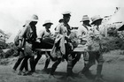 An all too familiar sight - stretcher-bearers coming in with a casualty at Gallipoli. Photo / New Zealand Herald
