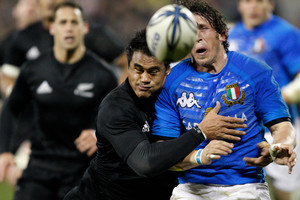 Italy's Mirco Bergamasco is hit hard in the tackle of New Zealand's Isaia Toeava in a 2009 test. Photo / NZPA File