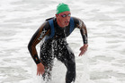 Kane Radford emerges from the water to finish second in the State Sand to Surf Swim at Mount Maunganui. Photo / Supplied