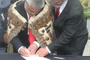 Haami Piripi, Te Rarawa leader, signs the Te Rarawa deed of settlement. Photo / Northern Advocate