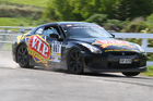 Tony Quinn and Naomi Tillet in the Nissan GTR that has owned Targa New Zealand in recent years. Photo / Fast Company, Ground Sky