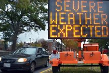 A road sign warns drivers of weather conditions in downtown Washington ahead of Hurricane Sandy's landfall. Photo / AFP