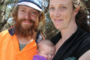 Sarah Flanagan and Clinton Watkins and their baby. Photo / Geoff Sloan