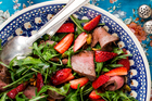 Strawberry salad with venison, rocket, pistachio and balsamic. Photo / Babiche Martens