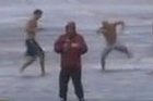 Reporting live on CNN and broadcasting worldwide, reporter Ali Velshi was joined by three male locals ready for a swim in a Hurricane Sandy 'video bomb'.