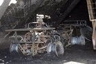 The remains of a quad bike after a fire in a shed on a Carterton farm. Photo / Wairarapa Times-Age
