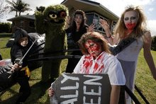 Getting ready for a good scare outside their Maunu home are Trinity Alp, age 9, in front, and behind her from left are ninja Pheonix Alp, age 7; Brayden Le Noel, age 12, as Oscar the Grouch; Leanne Martinovich and Mikayla Le Noel, age 10. Photo / Supplied