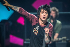 Green Day front man Billie Joe Armstrong is 'doing well' in rehab, the band says. Photo / AP