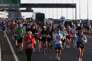 Runners cross the Auckland Harbour Bridge during the Auckland Marathon today. Photo / Getty Images