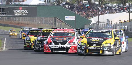 Race one startline negotiations between the top V8 SuperTourers qualifiers as they head into the esses at Pukekohe Park Raceway. Photo / Supplied