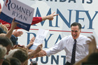 Republican presidential candidate, former Massachusetts Gov. Mitt Romney greets supporters at the Sanford International Airport, Sanford, Fla., on the last day of campaigning, Monday morning, Nov. 5,