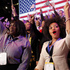 Supporters of President Barack Obama react to favorable media projections at the McCormick Place during an election night watch party in Chicago. Photo / AP