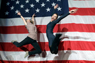 Supporters of President Barack Obama Shauna Harry, left, and Alana Hearn celebrate by leaping in the air at New York State Democratic Headquarters following Election Day. Photo / AP
