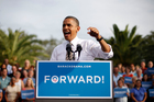 President Barack Obama gestures while speaking during a campaign event at Ybor City Museum State Park.