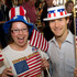 Kim Daly (left) and Jeremy Slezak from New Jersey celebrate President Obama's win while watching TV coverage of the American elections at the Revelry Bar in Ponsonby, Auckland. Photo / Steven McNicholl