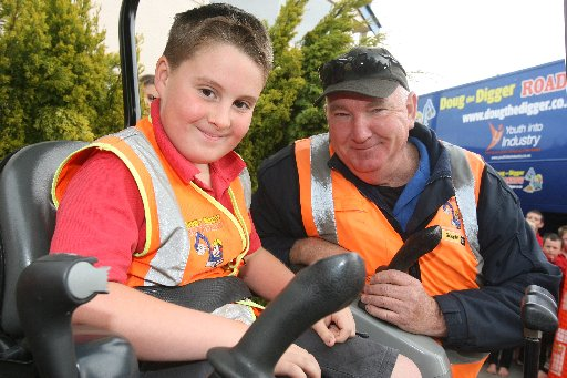 Doug the Digger at Greytown School  Seamus Bouldock, 9, in the digger with Alistair McIntyre.