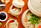 Crab, garlic chive and chestnut steamed dumplings. Photo / Babiche Martens