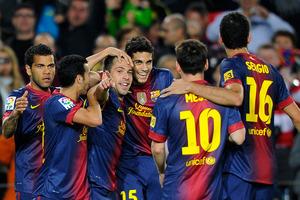 FC Barcelona's Jordi Alba, center, reacts after scoring against Celta Vigo during a Spanish La Liga soccer match at the Camp Nou stadium in Barcelona. Photo / Getty Images.