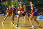 Tactix attacker Ellen Halpenny (centre) has been signed to replace Naoupu. Photo / Getty 